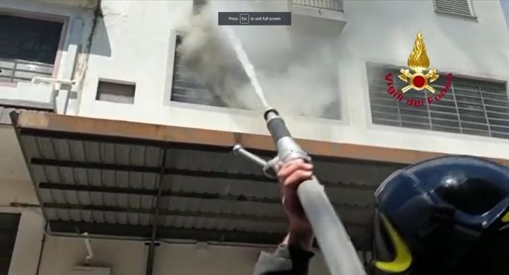 Italian firefighter hits textile factory fire from the ground. - Screencapture Via Tuscano Media