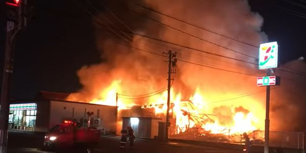 A factory fire in Japan Tuesday night threatened nearby homes and businesses.