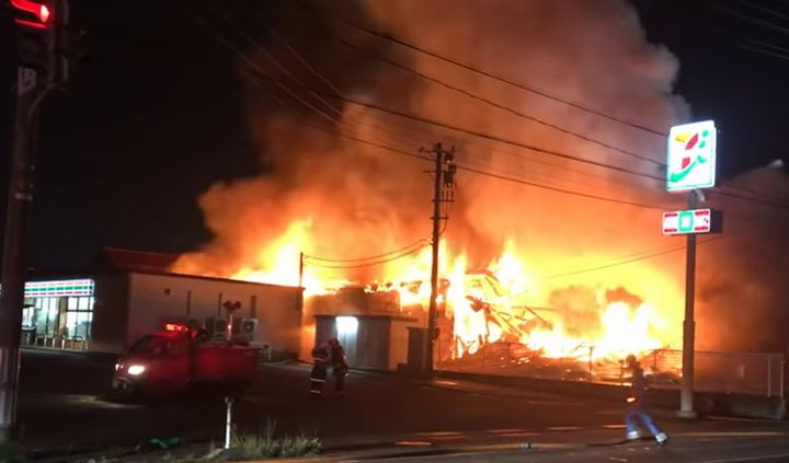 A factory fire in Japan Tuesday night threatened nearby homes and businesses. - Screencapture Via YouTube