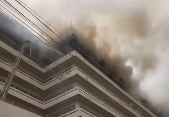 Flames raced through the upper floors of a high-rise factory Thursday in Pakistan. - Screencapture Via GNN