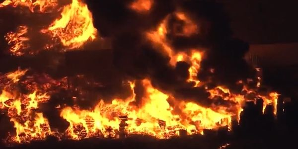 Drone video shows flames spread over multiple businesses in Sacramento, California, Monday.