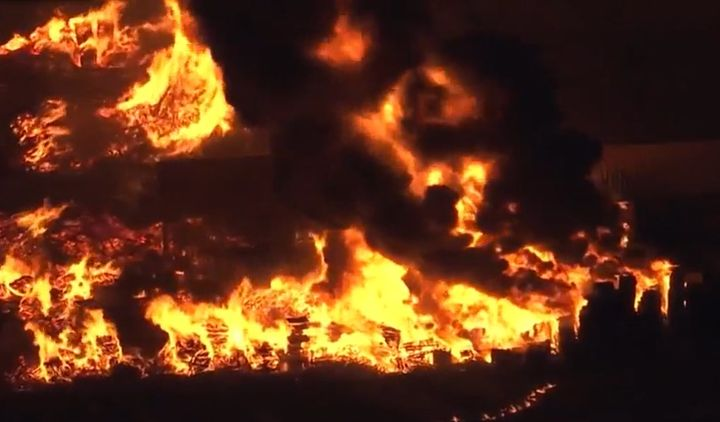 Drone video shows flames spread over multiple businesses in Sacramento, California, Monday. - Screencapture Via KCRA