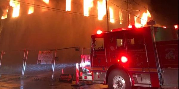 A vacant warehouse goes up in flames Friday in Louisville, Kentucky.