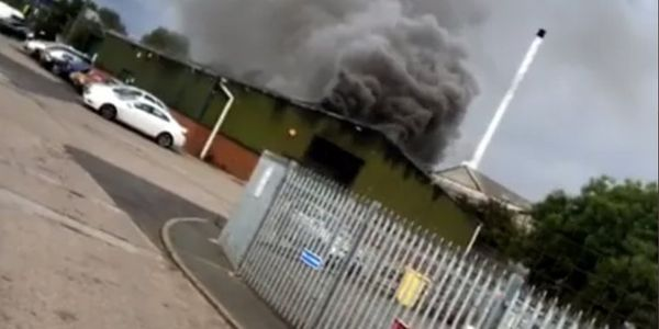 Thick smoke rises from a burning factory in Brierley Hill, UK.