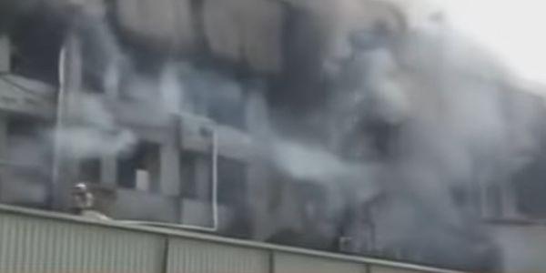 Smoke engulfs a mattress factory Monday in India.