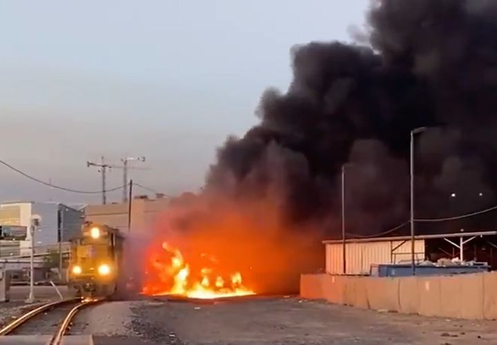 As many as five cars of a derailed freight moving through downtown Phoenix Friday caught fire. - Photo Courtesy of Phoenix Fire Department