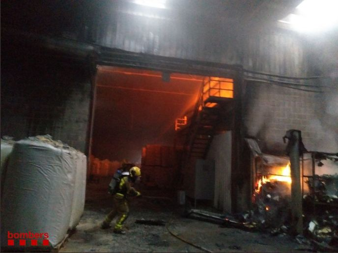 Firefighters battle a feed mill fire Sunday in Puigpelat, Spain. - Photo courtesy of Generalitat de Catalunya