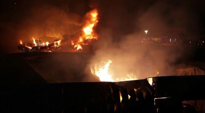 Night sky in Santo Tirso, Portugal, illuminated by factory fire Monday night. - Screencapture Via YouTube