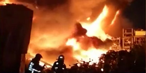 Flames spread through multiple factories Friday night in New Taipei City, Taiwan.