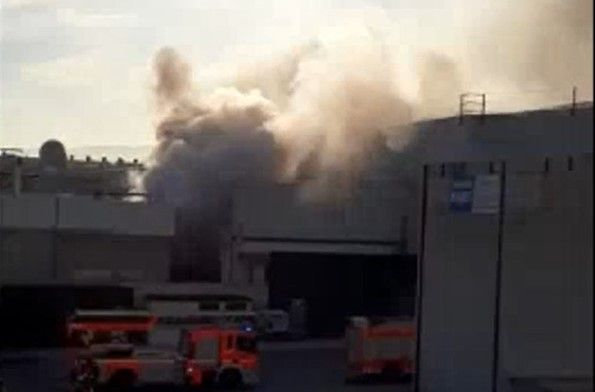 Smoke billows from a food processing plant Saturday in Spain. - Screencapture Via Levante-EMV