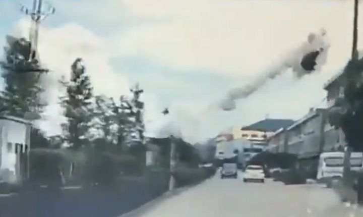 Flaming vehicle rockets across the sky after an LNG tanker exploded on a highway in eastern China Saturday. - Screencapture Via YouTube