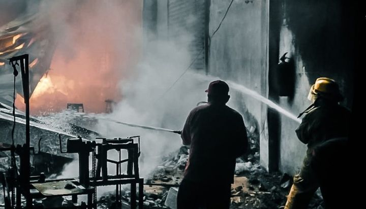 Firefighters advance on candle factory fire Thursday in Conkal, Mexico. - Photo Courtesy of SSP Yucatan