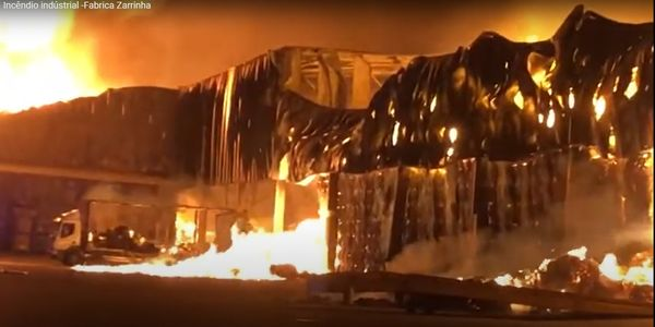 Flames broke out in a paper press at a cardboard factory in Portugal Monday.