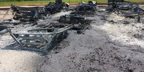Burned out shell of storage trailers destroyed at Arkema Chemical during Hurricane Harvey.