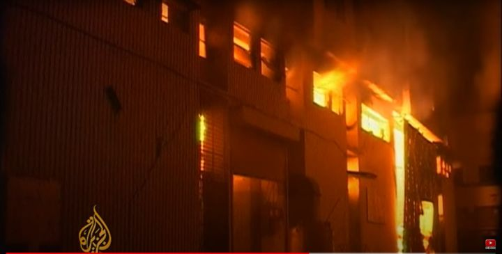September 2012 factory fire in Karachi, Pakistan, killed 258 workers. - Screencapture Via Al Jazeera