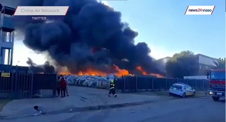 Five fire stations were involved in extinguishing a recycling plant fire in South Africa Sunday. - Screencapture Via YouTube