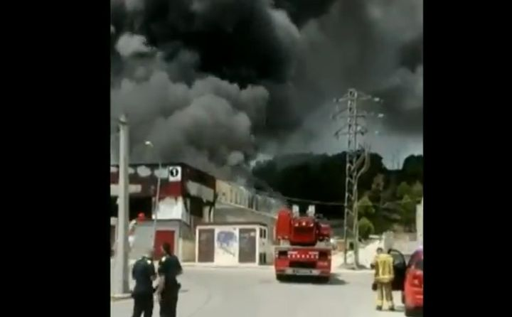 Thick black smoke dominates the sky above a food processing plant Sunday in Spain. - Photo courtesy ofGeneralitat de Catalunya