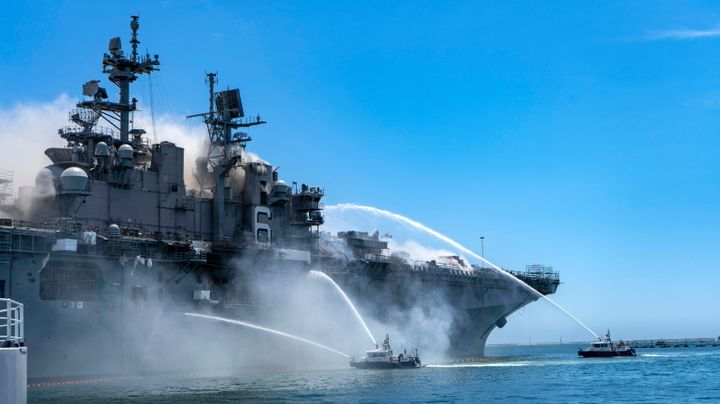 Port of San Diego Harbor Police Department boats combat a fire onboard USS Bonhomme Richard at Naval Base San Diego. - U.S. Navy photo by Mass Communication Specialist 3rd Class Christina Ross