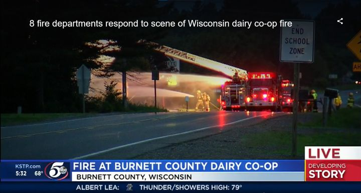 Fire crews battle flames at a dairy cooperative Monday night in Wisconsin. - Screencapture Via KSTP
