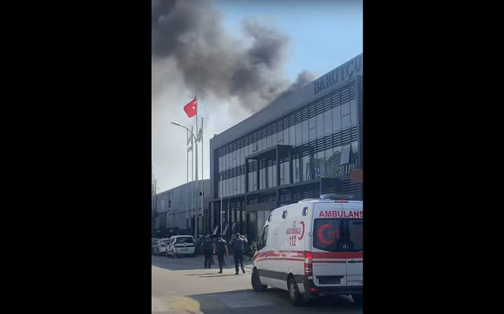 Emergency vehicles gather at a burning textile mill in Bursa, Turkey. - Screencapture Via YouTube
