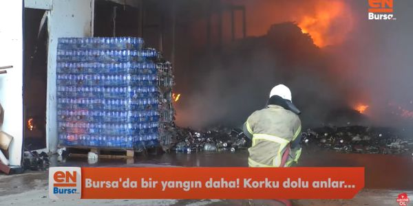 Firefighter takes a position at the mouth of a burning Styrofoam factory in Turkey Thursday.