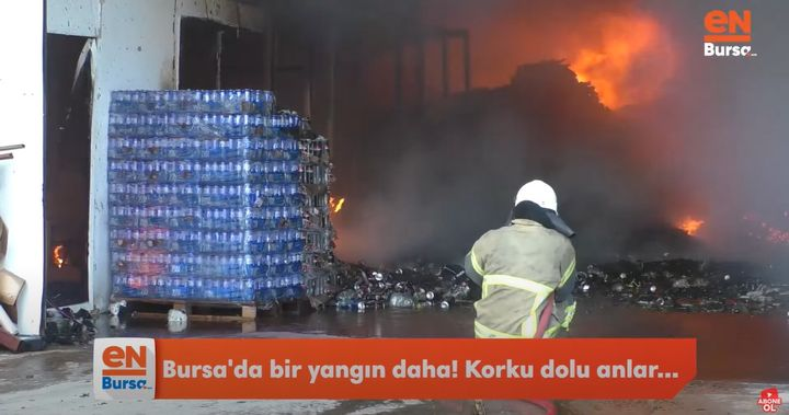 Firefighter takes a position at the mouth of a burning Styrofoam factory in Turkey Thursday. - Screencapture Via EnBursa TV