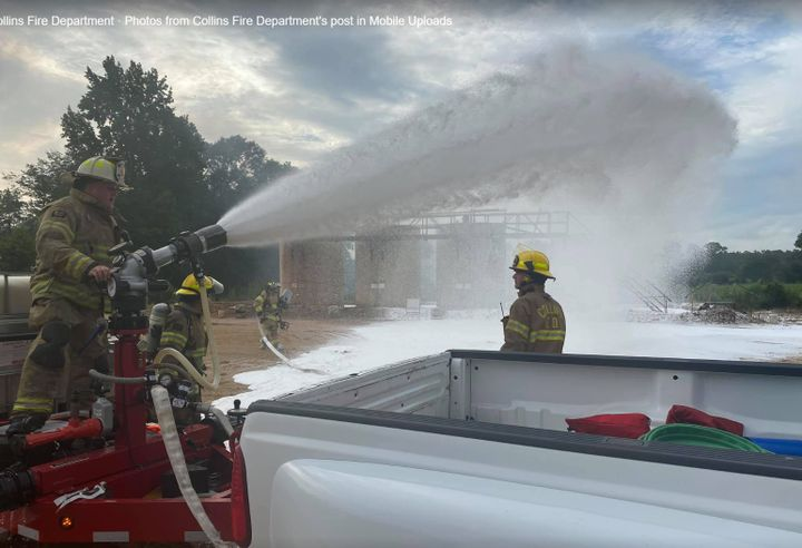 Firefighting foam is brought to bear against a crude oil storage tank fire in Mississippi Tuesday. - Photo Courtesy of Collins Fire Department