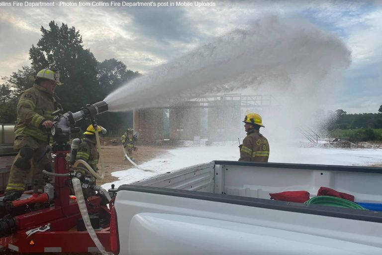 Firefighting foam is brought to bear against a crude oil storage tank fire in Mississippi Tuesday.