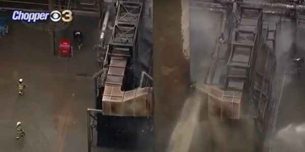 Aerial view of firefighters delivering water during a March 2020 refinery fire in Delaware.