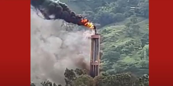 Flames rise from the flaring stack at a chemical plant in Colombia.