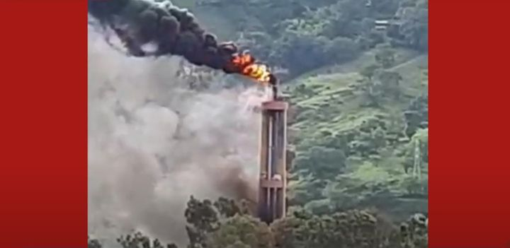 Flames rise from the flaring stack at a chemical plant in Colombia. - Screencapture Via YouTube