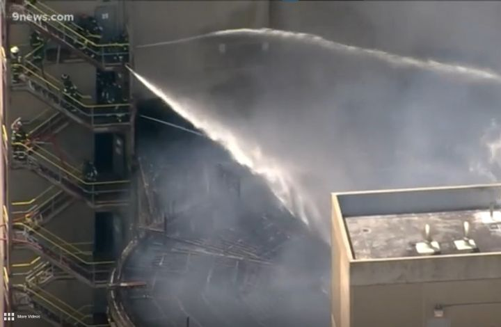 Firefighters scales a 16 story brewery Thursday in Golden, Colorado, to apply water to the roof of a burning silo. - Screencapture Via KUSA