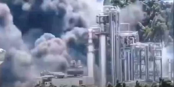 Fire crept through a bio-fuel tank farm in Longyan, China, Monday.
