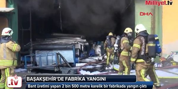 Firefighter enter a burning conveyor belt factory in Istanbul Thursday.