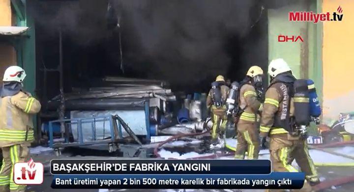 Firefighter enter a burning conveyor belt factory in Istanbul Thursday. - Screencapture Via Milliyet TV