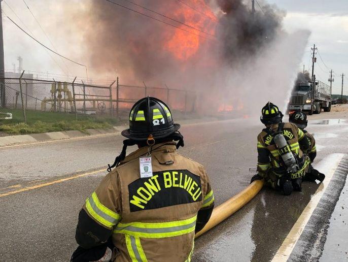 Firefighter apply water to a fire burning from a ruptured pipeline Wednesday near Mont Belvieu, Texas. - Photo courtesy of Mont Belvieu Fire Department