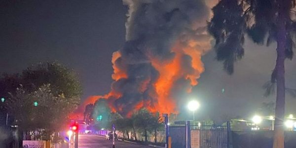 Massive fire dominates the skyline in southern Sydney Thursday night.