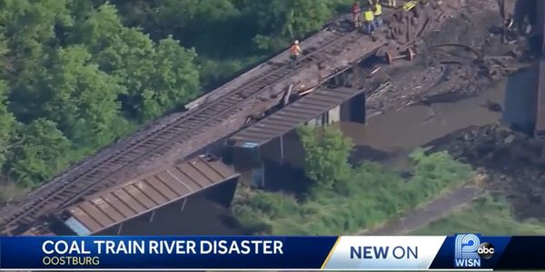 Coal from a derailed train spilled into the Black River in Wisconsin Sunday.