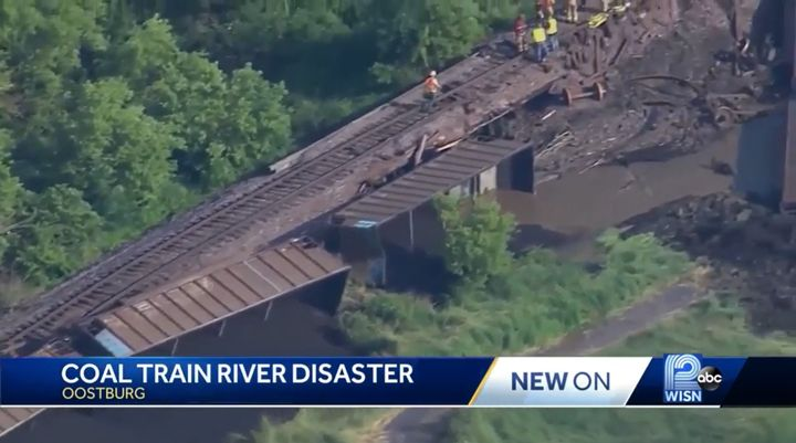 Coal from a derailed train spilled into the Black River in Wisconsin Sunday. - Screencapture Via WISN
