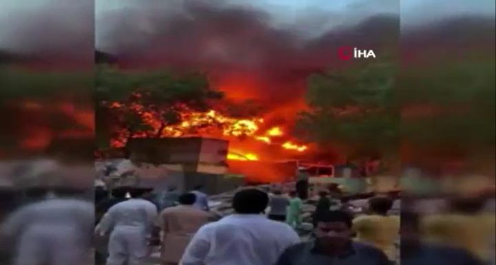 Fire spread through Export Processing Zone in Karachi, Pakistan. - Screencapture Via Bursada Bugun