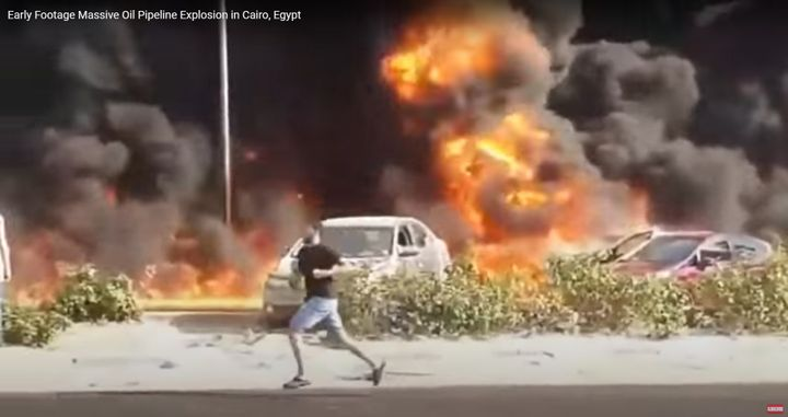 Flames spread along a Cairo roadway when a ruptured crude pipeline ignited Tuesday. - Screencapture Via YouTube