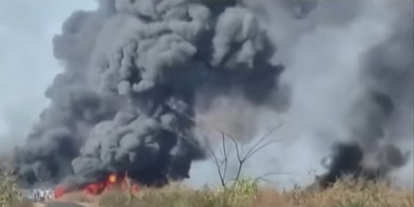 Flames spread through the wetlands surrounding an oil well blowout that ignited Tuesday in India.