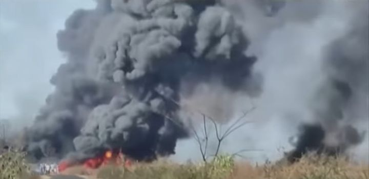 Flames spread through the wetlands surrounding an oil well blowout that ignited Tuesday in India. - Screencapture Via Republic