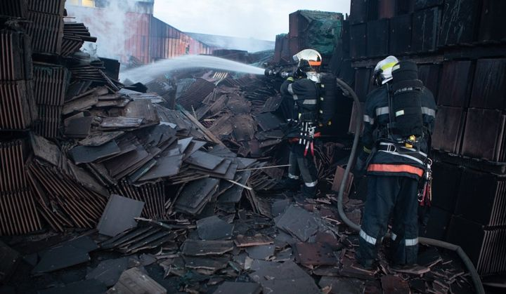 Firefighters hose down the damage inventory of a tile factory in France. - Photo courtesy of SDIS 60