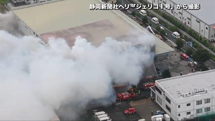 Smoke rises from a burning warehouse Sunday morning in Yoshida, Japan. - Screencapture Via Shizuoka Shinbun