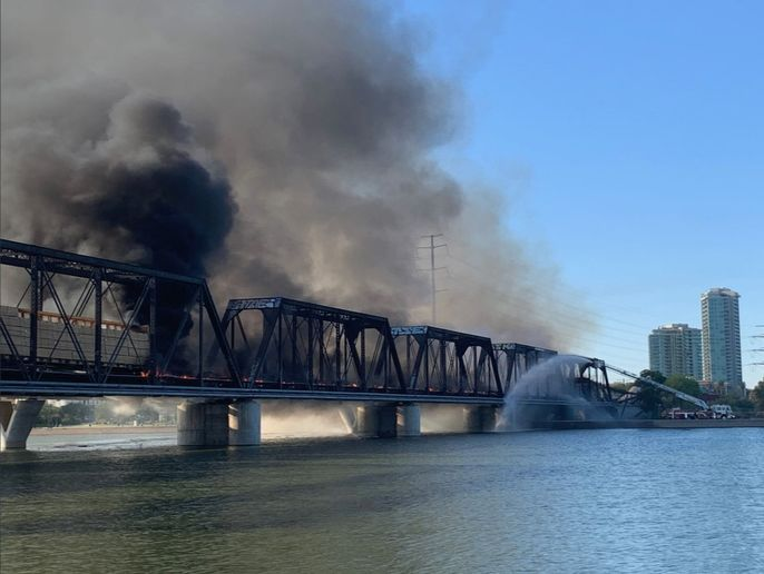 Fire collapsed a portion of a railroad bridge near Phoenix Tuesday after a train derailed. - Photo courtesy of Tempe Police