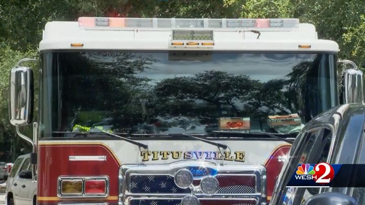 Titusville, Florida, fire truck waits outside the scene of a factory explosion Thursday. - Screencapture Via WESH