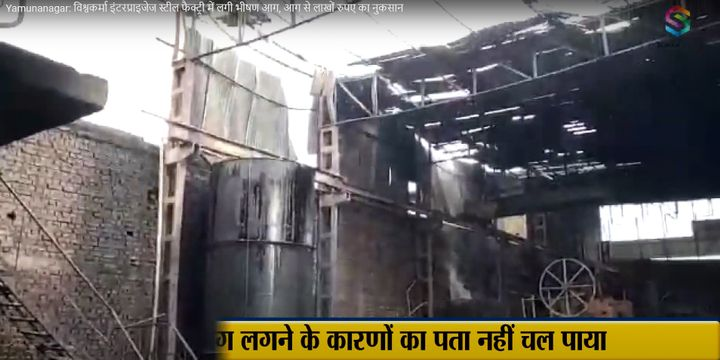 The flame gutted interior of a metals factory in India. - Screencapture Via SokkaTimes