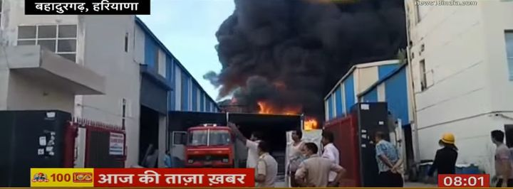 Flames consume a lubricant plant in India. - Screencapture Via News 18 India