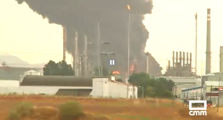 Two storage tanks burn at an oil refinery in Spain Monday. - Photo Courtesy of CMM